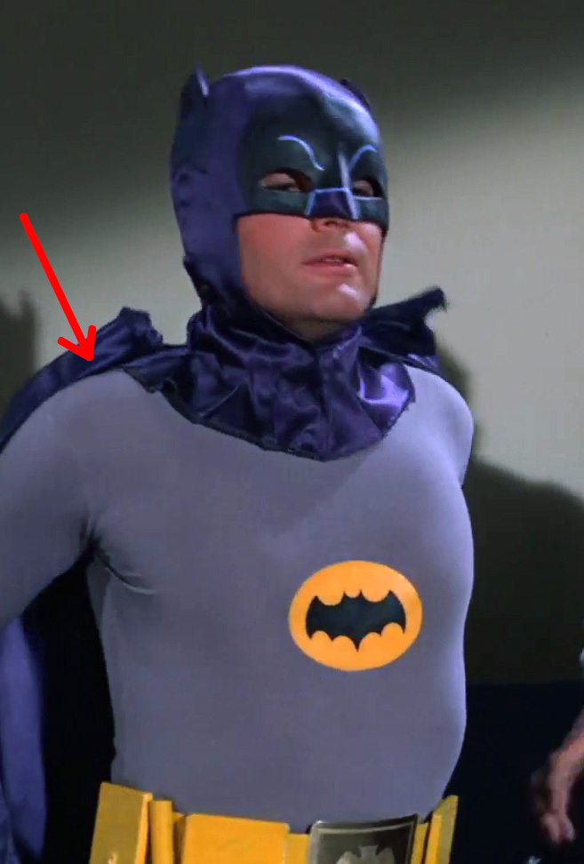 Note the cape stays attached to the snaps while it is being removed in this scene.