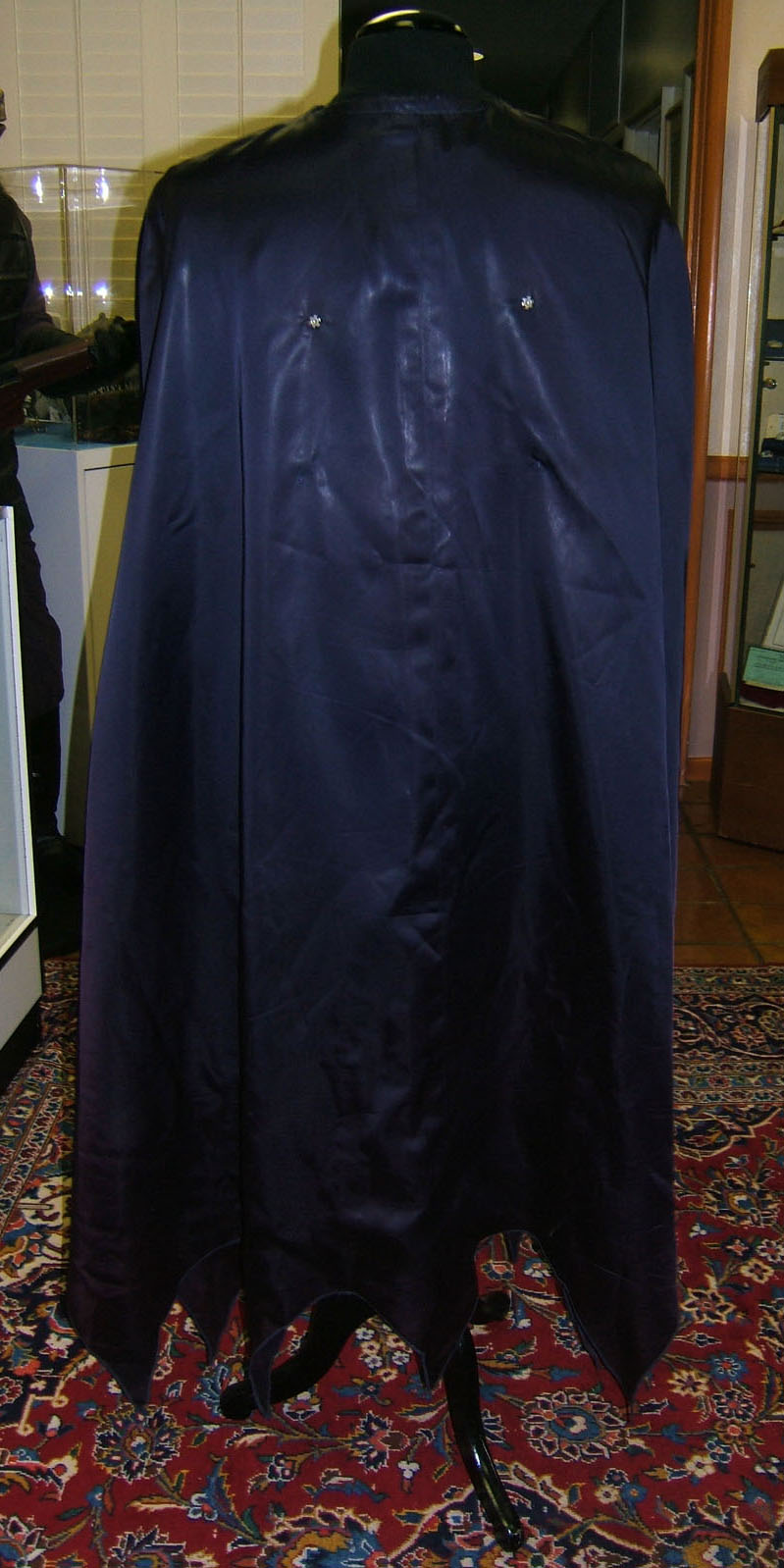 Back of cape with snaps that attach to front snaps.